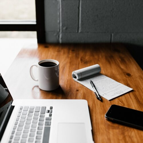 computer on desk with mug